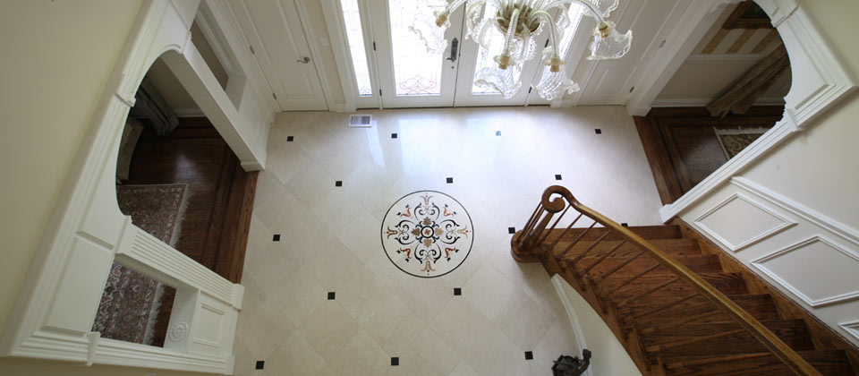 Fuda Tile Showcase Picture - Entry Foyer with Custom Waterjet Medallion and 18x18 Italian Marble